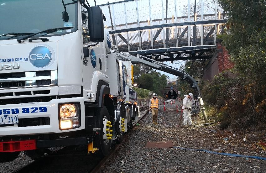 Hydro excavation with hi-rail truck